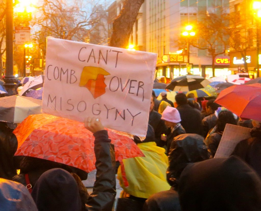 A protest sign: You can't comb over misogyny