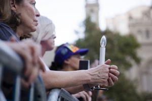 Attendees of a memorial in Las Vegas, NV