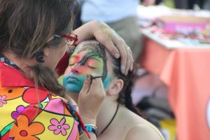 A person applying face paint.