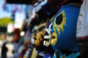 Lucha libre masks on display.