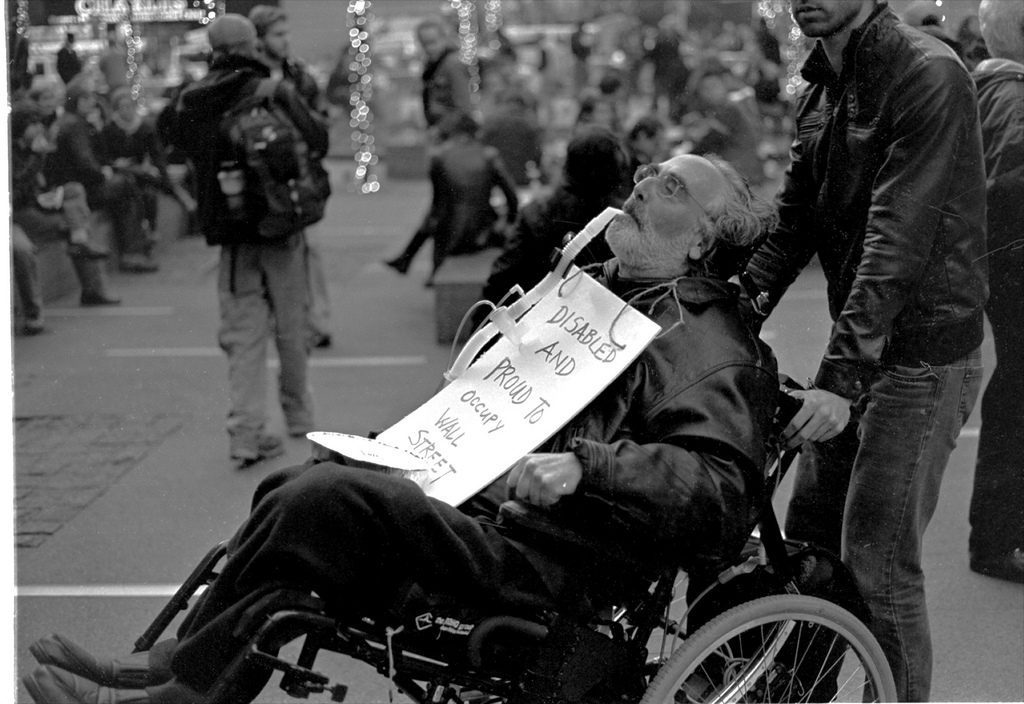 A disabled person at a protest