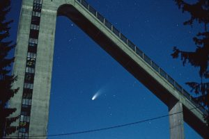 Comet Hale-Bopp framed by a ski jumping structure