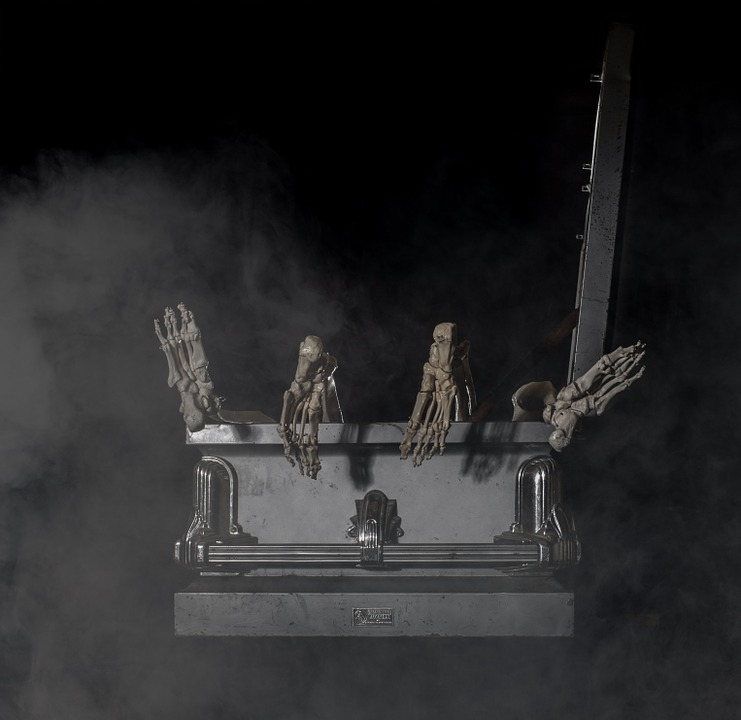 A coffin with a skeleton emerging.