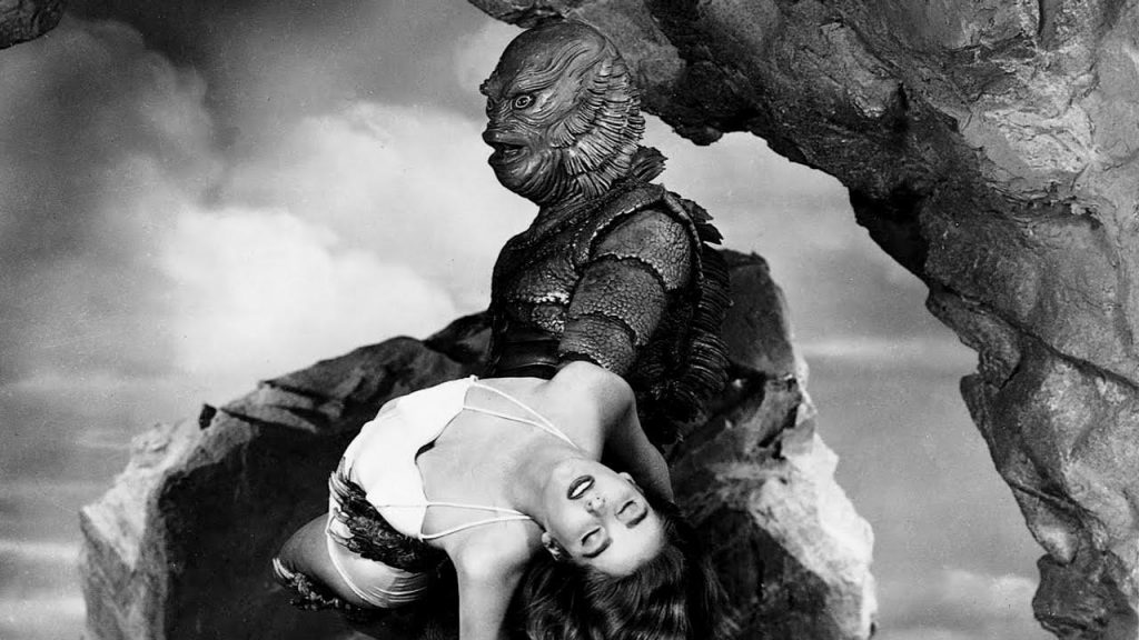 The Creature from the Black Lagoon with a comely female victim