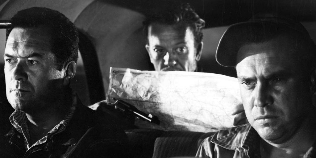 A still from The Hitchhiker, showing the three characters trapped in a car.