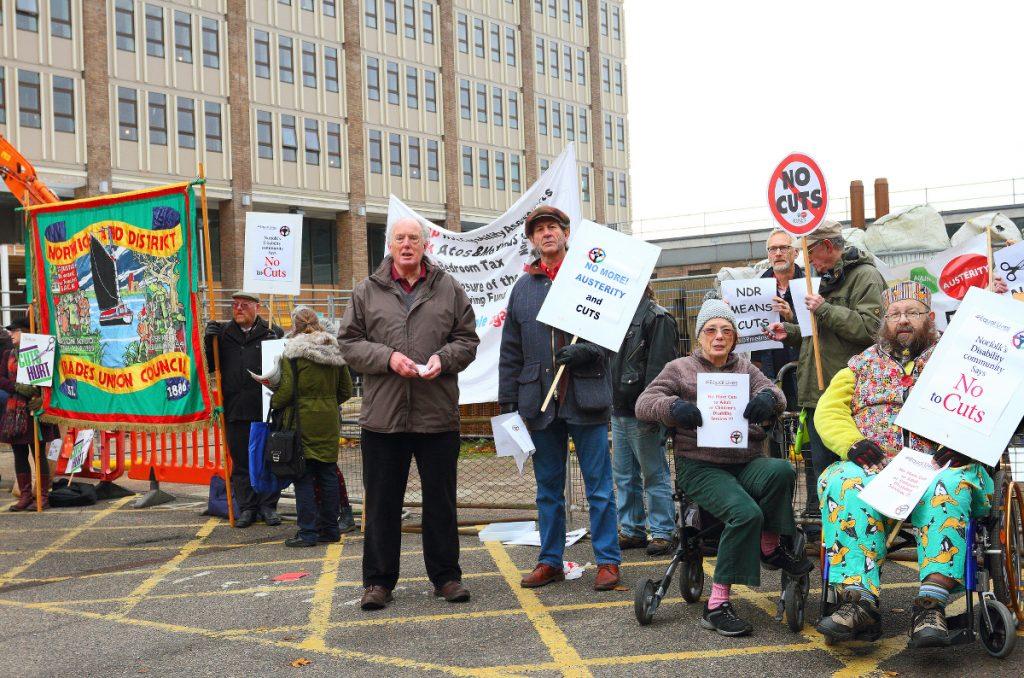 Disabled activists protesting cuts.