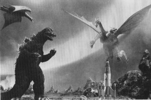 A film still featuring Godzilla and Ghidorah in a faceoff.