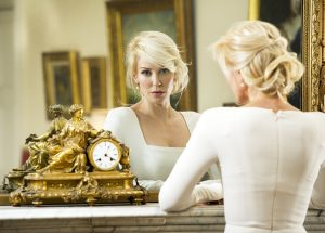 Louise Linton staring broodily into a mirror.