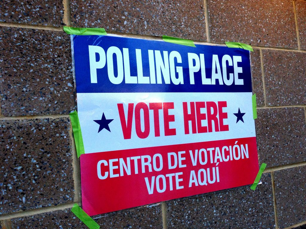 A sign directing people to a polling place.