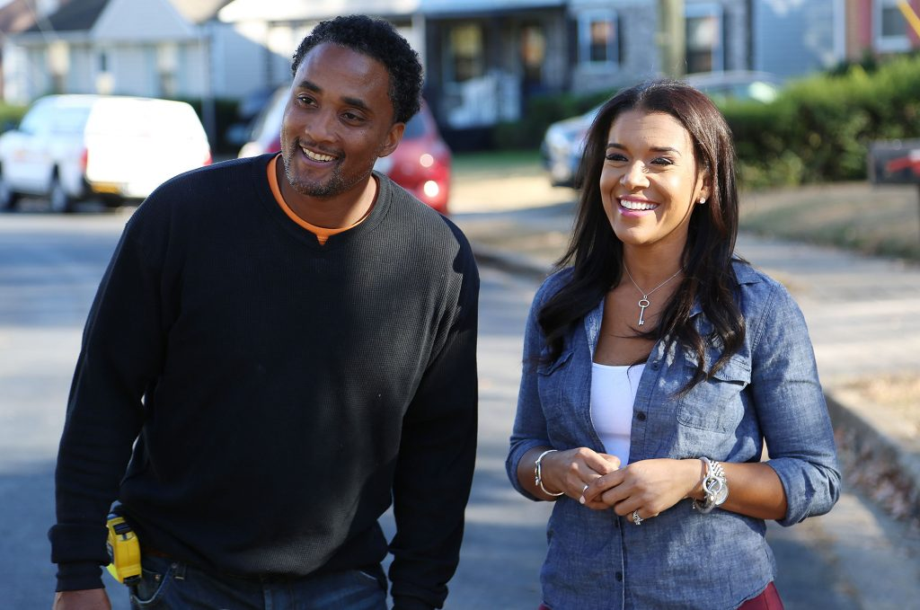 A Black man and woman smiling.